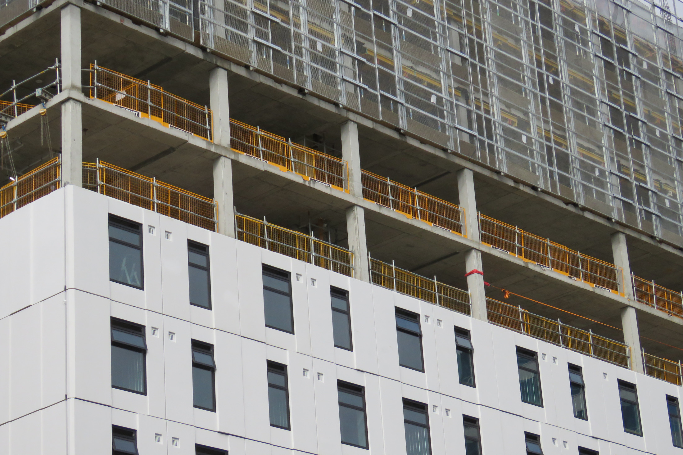 Pre-finished panels erected on an Auckland city high rise project